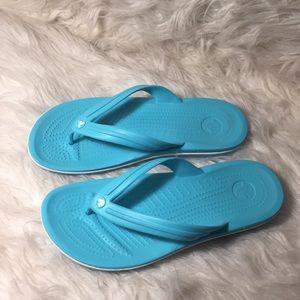 Super cute crocs flip flops.